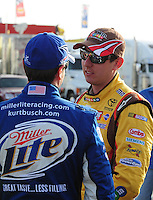 Feb. 27, 2009; Las Vegas, NV, USA; NASCAR Sprint Cup Series driver Kyle Busch (right) talks with brother Kurt Busch during qualifying for the Shelby 427 at Las Vegas Motor Speedway. Mandatory Credit: Mark J. Rebilas-