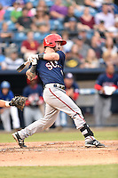 Hagerstown Suns catcher Matt Reistetter (11) swings at a pitch during a game against the  Asheville Tourists at McCormick Field on September 4, 2016 in Asheville, North Carolina. The Suns defeated the Tourists 10-5. (Tony Farlow/Four Seam Images)