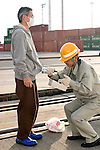 A member of the so-called Fukushima 50 is given a radiation check prior to boarding the Kaiwomaru in the dock at Onahama Port, Iwaki City, Fukushima Prefecture on  23 March 20011.  .Photographer: Robert GilhoolyA member of the so-called Fukushima 50 is given a radiation check prior to boarding the Kaiwomaru in the dock at Onahama Port, Iwaki City, Fukushima Prefecture on  23 March 20011.  .Photographer: Robert Gilhooly