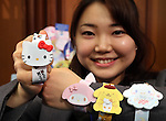 February 8, 2017, Tokyo, Japan - Japan's character giant Sanrio employee displays Sanrio's characters designed wrist watch at the company's latest products exhibition at Sanrio headquarters in Tokyo on Wednesday, February 8, 2017. The watch displays time with LED and priced 1,500 yen (14 US dollars).    (Photo by Yoshio Tsunoda/AFLO) LwX -ytd-