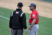 Jose Moreno #24, manager of the High Desert Mavericks, argues a call with Umpire John Bostwick during game against the Rancho Cucamonga Quakes at The Epicenter in Rancho Cucamonga,California on May 8, 2011. Photo by Larry Goren/Four Seam Images