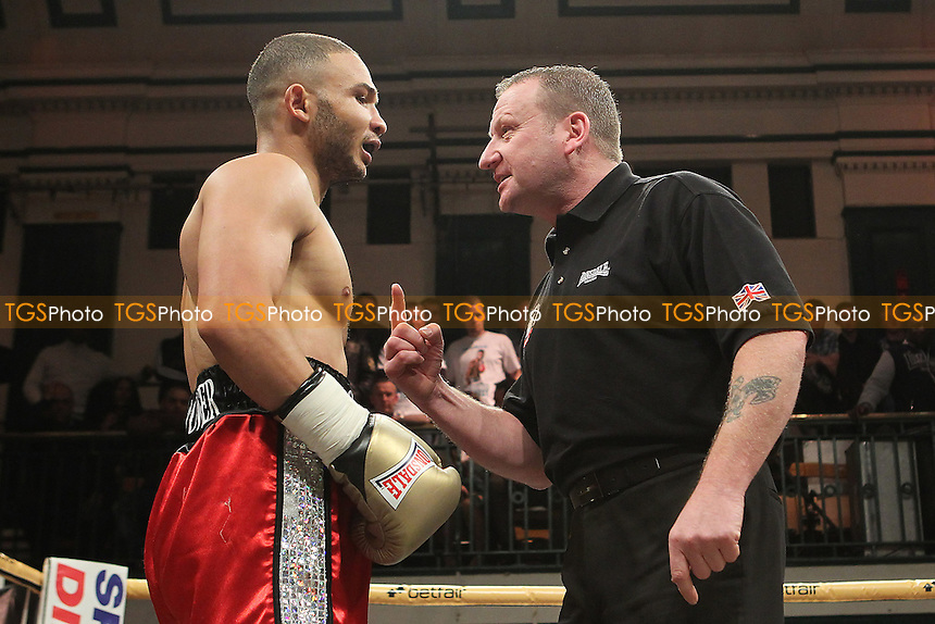 Navid Mansouri (black/gold shorts) defeats Curtis Valentine in a Prizefighter The Light-Middleweights III boxing contest at York Hall, Bethnal Green, London, promoted by Matchroom Sports - 03/11/12 - MANDATORY CREDIT: Gavin Ellis/TGSPHOTO - Self billing applies where appropriate - 0845 094 6026 - contact@tgsphoto.co.uk - NO UNPAID USE.