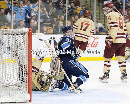 Parker Milner (BC - 35), Klas Leidermark (Maine - 91), Edwin Shea (BC - 8) - The Boston College Eagles defeated the University of Maine Black Bears 4-1 to win the 2012 Hockey East championship on Saturday, March 17, 2012, at TD Garden in Boston, Massachusetts.