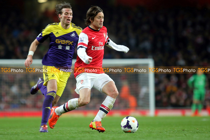 Tomas Rosicky of Arsenal in action as Swansea's Miguel Michu looks on - Arsenal vs Swansea City - Barclays Premier League Football at the Emirates Stadium, London - 25/03/14 - MANDATORY CREDIT: Paul Dennis/TGSPHOTO - Self billing applies where appropriate - 0845 094 6026 - contact@tgsphoto.co.uk - NO UNPAID USE