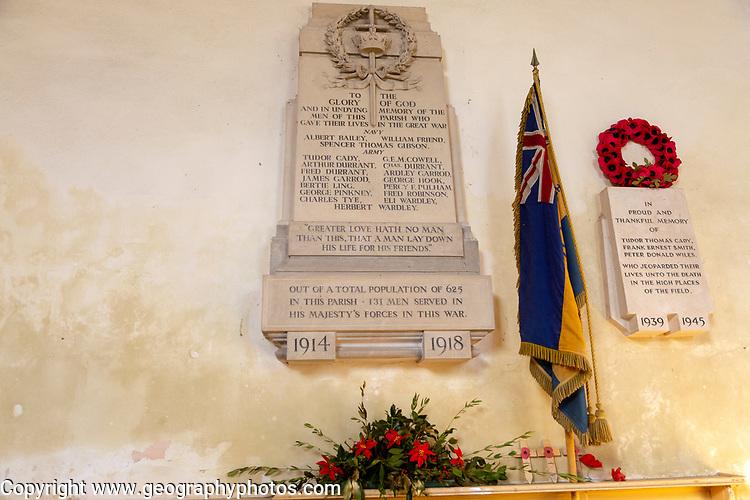 War memorial flag and poppy wreath inside the church at Tunstall, Suffolk, England, UK