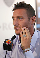 Il capitano della Roma Francesco Totti tiene una conferenza stampa insieme al presidente in occasione del rinnovo del suo contratto, al centro sportivo Fulvio Bernardini di Trigoria, Roma, 20 settembre 2013.<br /> AS Roma football club captain Francesco Totti  attends a joint press conference with club's president in occasion of the renewal of his contract at the club's sporting center in Rome, 20 September 2013.<br /> UPDATE IMAGES PRESS/Isabella Bonotto