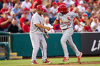 Ronny Gil (73) of the St. Louis Cardinals is congratulated by Third Base coach Jose Oquendo (11) after hitting a home run to right field during a game against the Springfield Cardinals at Hammons Field on April 2, 2012 in Springfield, Missouri. (David Welker/Four Seam Images)