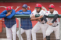 Lansing Lugnuts players (L to R) Yennsy Diaz (30), Vladimir Guerrero Jr. (27) and Rodrigo Orozco (4) watch with Toronto Blue Jays Special Assistant Sandy Alomar Sr. from the dugout during the Midwest League baseball game against the Bowling Green Hot Rods on June 29, 2017 at Cooley Law School Stadium in Lansing, Michigan. Bowling Green defeated Lansing 11-9 in 10 innings. (Andrew Woolley/Four Seam Images)