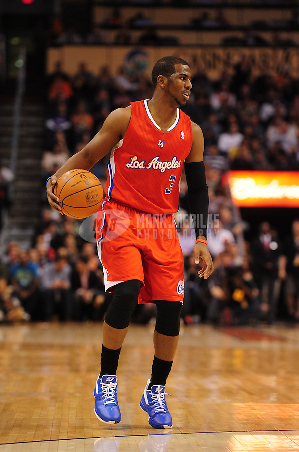 Mar. 2, 2012; Phoenix, AZ, USA; Los Angeles Clippers guard Chris Paul dribbles down court during game against the Phoenix Suns at the US Airways Center. The Suns defeated the Clippers 81-78. Mandatory Credit: Mark J. Rebilas-USA TODAY Sports