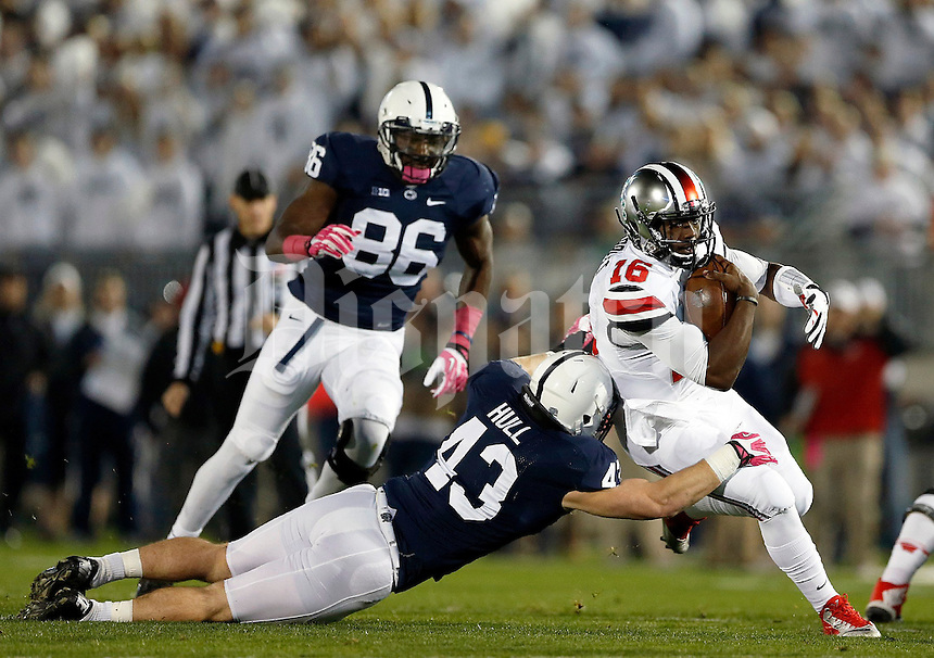 Ohio State Buckeyes quarterback J.T. Barrett (16) gets past Penn State Nittany Lions linebacker Mike Hull (43) during the first quarter of the NCAA Division I football game at Beaver Stadium in University Park, PA on October 25, 2014. (Columbus Dispatch photo by Jonathan Quilter)