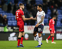 Bolton Wanderers' Josh Magennis shakes hands with  Walsall's Jon Guthrie at the end of the match<br /> <br /> Photographer Andrew Kearns/CameraSport<br /> <br /> Emirates FA Cup Third Round - Bolton Wanderers v Walsall - Saturday 5th January 2019 - University of Bolton Stadium - Bolton<br />  <br /> World Copyright &copy; 2019 CameraSport. All rights reserved. 43 Linden Ave. Countesthorpe. Leicester. England. LE8 5PG - Tel: +44 (0) 116 277 4147 - admin@camerasport.com - www.camerasport.com