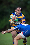 Haani Halaeua looks to fend off Whairoa Rangiwhai's tackle during the Counties Manukau Premier Club Rugby game between Patumahoe and Ardmore Marist, played at Patumahoe, on Saturday June 07 2014. Patumahoe won the game 23- 3 after being 3 all at halftime  Photo by Richard Spranger