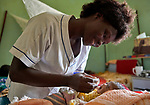 Nurse Annet Kojo feeds a 4-day old baby girl in the maternity ward of the St. Daniel Comboni Catholic Hospital in Wau, South Sudan. Kojo is a 2017 graduate of the Catholic Heath Training Institute in Wau. The CHTI is sponsored by Solidarity with South Sudan.