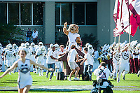 Bully and the cheerleaders running on to the field during pregame.<br />