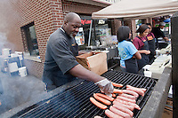 A man grills sausages in Detroit Eastern Farmers market in Detroit (Mi) Saturday June 8, 2013. The largest open-air flowerbed market in the United States, the Eastern Market is a historic commercial district in Detroit, Michigan.