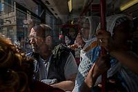 Rome, Italy, April 4, 2017. Gente in un autobus affollato. People in the bus.<br /> Ad un anno dalla elezione a sindaco di Roma di Virginia Raggi, la condizione di degrado non accenna a migliorare.<br /> One year after the election as mayor of the candidate of M5S party, Rome is worsening day by day.