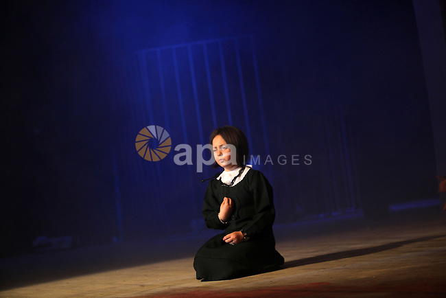 "A Palestinian girl performs in the play ""Freedom sings"" in Gaza city on April 15, 2013. The play organised by Waed society, talks about the the life of Palestinian prisoners in Israeli jails and the Palestinian resistance, ahead of Palestinian prisoners day on April 17. Photo by Ashraf Amra"