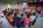 Participants form a circle during an ecumenical workshop on women's empowerment in Kalay, Myanmar. The workshop was sponsored by the Women's Department of the Myanmar Council of Churches and led by Emma Cantor, a regional missionary for United Methodist Women.