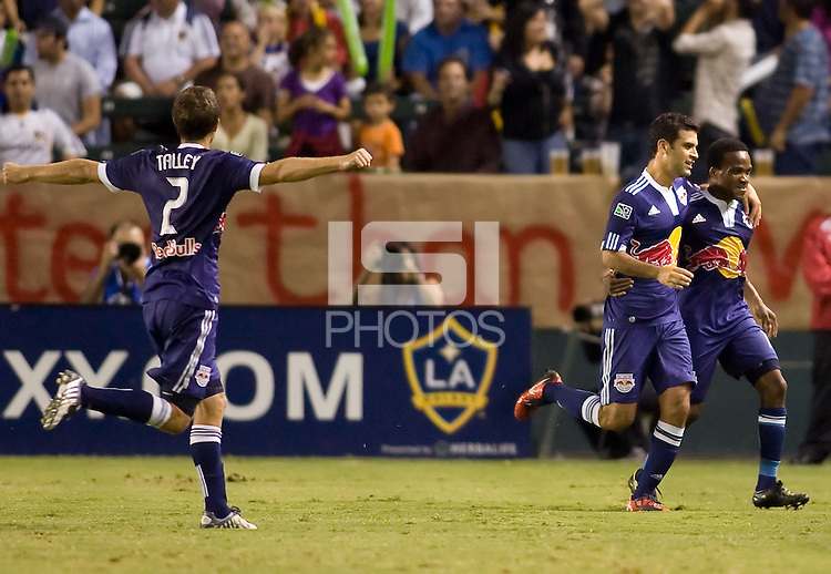 Rafael Marquez and teammate Dane Richards begin to celebrate a Dane Richards goal as Carey Talley comes to join in. The New York Red Bulls beat the LA Galaxy 2-0 at Home Depot Center stadium in Carson, California on Friday September 24, 2010.