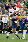 Tampa Bay Buccaneers quarterback Josh Freeman (5) looks for a receiver during a Week 11 NFL football game against the Green Bay Packers on November 20, 2011 in Green Bay, Wisconsin. The Packers won 35-26. (AP Photo/David Stluka)