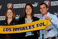 The eighth overall pick in the WPS draft , Casey Nogueira with WPS commissioner Tonya Antonucci and Los Angeles Sol head coach Abner Rogers (R) during the WPS Draft at the Pennsylvania Convention Center in Philadelphia, PA, on January 15, 2010.