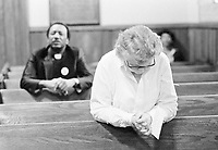 "Two Atlantans pray at a vigil being kept for the missing and murdered children of the city, Feb. 27, 1981. The church committee of the NAACP organized the vigil not only for the children, ""but for the killer too,"" said committee member Shirley Harris. (AP Photo/Gary Gardiner)"