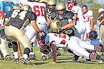 Palos Verdes, CA 11/12/10 - Michael Tulchin (Palos Verdes #21), Haden Gregory (Peninsula #42) and Jin Matsumoto (Peninsula #40) in action during the Palos Verdes - Peninsula varsity football game at Peninsula High School.