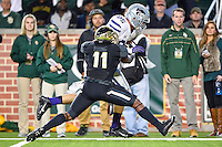 Baylor linebacker Taylor Young (11) attempts to prevent Kansas State tight end Zach Trujillo (85) from scoring a touchdown during an NCAA football game, Saturday, December 06, 2014 in Waco, Tex. Baylor defeated Kansas State 38-27. (Mo Khursheed/TFV Media via AP Images)