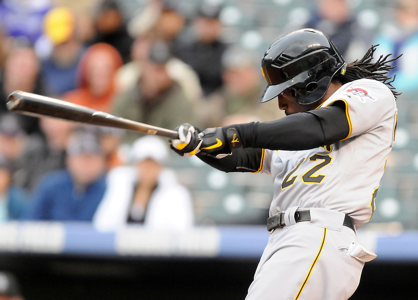 30 APRIL 2011:     Pittsburgh Pirates center fielder Andrew McCutchen (22) hits a leadoff homerun during a regular season game between the Pittsburgh Pirates and the Colorado Rockies at Coors Field in Denver, Colorado. The Rockies beat the Pirates 4-1. *****For Editorial Use Only*****