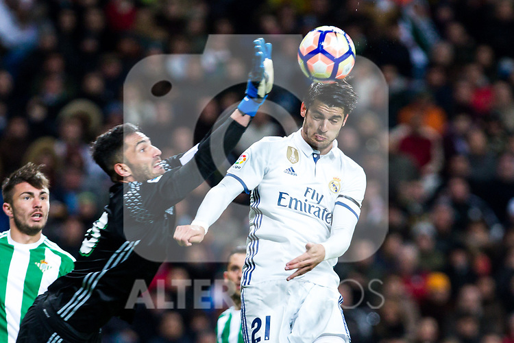 Antonio Adan of Real Betis competes for the ball with Alvaro Morata of Real Madrid  during the match of Spanish La Liga between Real Madrid and Real Betis at  Santiago Bernabeu Stadium in Madrid, Spain. March 12, 2017. (ALTERPHOTOS / Rodrigo Jimenez)
