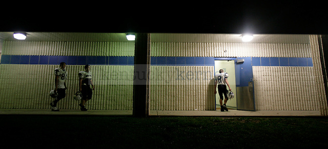 Jared Waddles, right, walks into the locker room at Pike County Central High School after losing 46-19 on Friday, Sept 18, 2009.