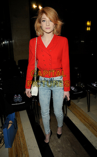 NICOLA ROBERTS of GIRLS ALOUD.Attending the Bodyamr  Fashion Show during London Fashion Week, London, England, UK, 19th February 2010.LFW full length red jacket double breasted acid wash denim jeans black shoes skinny Chanel chain shoulder strap bag white pointy waist belt .CAP/CAN.©Can Nguyen/Capital Pictures.