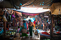 India - Manipur - Imphal - Buyers (mostly housewives) stroll in the market aisles early in the morning to catch the fresh produces.