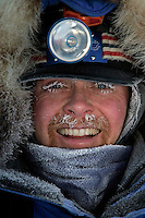Tuesday March 6, 2007   Rainy Pass checkpoint----  Clint Warnke is frosted up at the Rainy Pass checkpoint on Puntilla Lake at 20 below zero with 15-20 mph winds on Tuesday morning