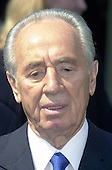 Foreign Minister Shimon Peres of Israel meets reporters outside the White House following his meeting with United States President George W. Bush on May 3, 2001.<br /> Credit: Ron Sachs / CNP