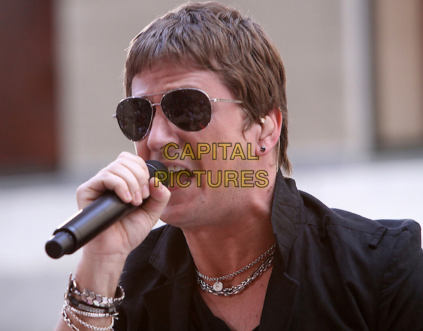 "ROB THOMAS .Performs live on NBC's ""TODAY"" Show, New York, NY, USA, 3rd July 2009..portrait headshot sunglasses black shirt microphone performing gig on stage music aviators singing silver bracelets necklace ear piece .CAP/ADM/PZ.©Paul Zimmerman/Admedia/Capital Pictures"