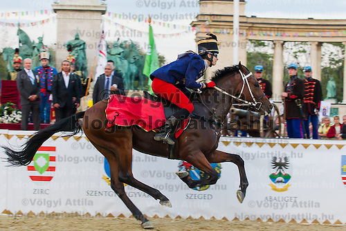 Jennifer Vass of Hungary leads with her horse Cordoba during the National Galop equestrian festival in Budapest, Hungary on September 16, 2012. ATTILA VOLGYI