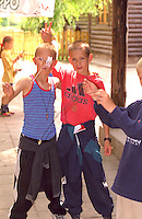 Friends age 12 playing with yo yos. Ancient Slavic Settlement Biskupin Poland