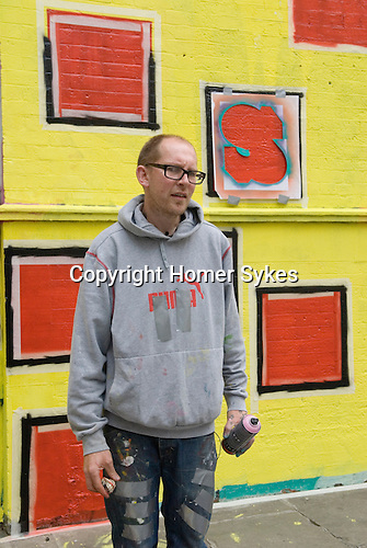 Ben Eine street artist. Creating new work in Middlesex Street London E1 (real name Ben Flynn)