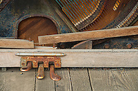 Old piano footpedals and strings