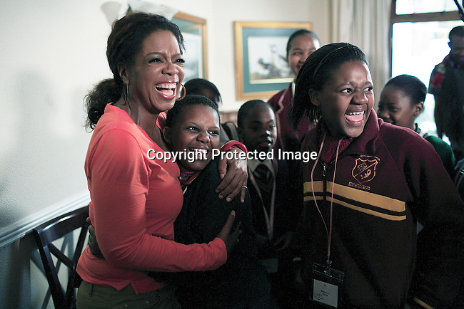"JOHANNESBURG, SOUTH AFRICA AUGUST 10: Oprah talks to a group of girls after interviewing them for her school ""Oprah Winfrey Leadership Academy for Girls"" located about 40 miles south of Johannesburg in Henley-on-Klip, Meyerton. Oprah visited South Africa to interview girls and to inspect the construction of the school. (Photo by Per-Anders Pettersson).."