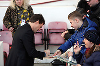 Pictured: Swansea manager Michael Laudrup signs autographs for fans. 01 February 2014<br />