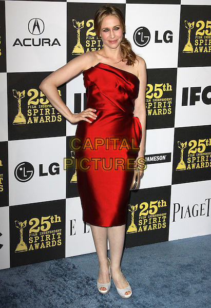 VERGA FARMIGA .25th Annual Film Independent Spirit Awards held At The Nokia LA Live, Los Angeles, California, USA,.March 5th, 2010 ..arrivals Indie Spirit full length red strapless dress silk satin hand on hip peep toe shoes white cream .CAP/ADM/KB.©Kevan Brooks/Admedia/Capital Pictures
