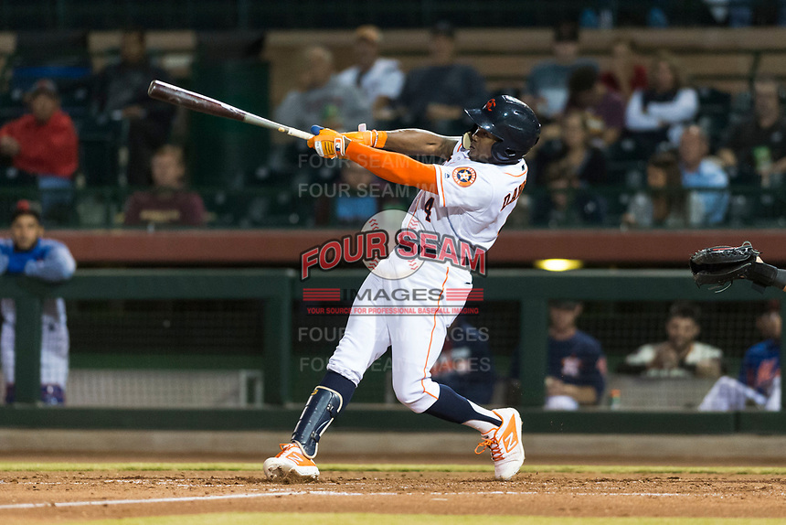Scottsdale Scorpions center fielder Ronnie Dawson (4), of the Houston Astros organization, swings at a pitch during an Arizona Fall League game against the Surprise Saguaros at Scottsdale Stadium on October 15, 2018 in Scottsdale, Arizona. Surprise defeated Scottsdale 2-0. (Zachary Lucy/Four Seam Images)