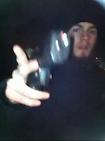 Pictured: Video grab showing Kristen Brekke holding a handgun on a hill in Cardiff known as Asda Hill<br />