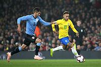Neymar Jr of Brazil outpaces Uruguay's Rodrigo Bentancur during Brazil vs Uruguay, International Friendly Match Football at the Emirates Stadium on 16th November 2018