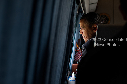 United States President Barack Obama looks out the window of Marine One as he departs the White House South Lawn en route to Joint Base Andrews, Maryland, for a trip to Vermont, March 30, 2012. .Mandatory Credit: Pete Souza - White House via CNP