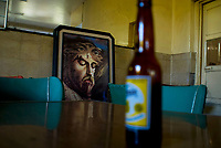 A portrait of Jesus rests on a chair at El Principio Cantina in the Tepito neighbourhood of Mexico City September 18, 2007