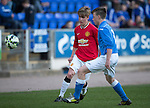 St Johnstone Academy v Manchester United Academy....17.04.15   <br /> Kieran Freeman chips the ball past Gus Mailer<br /> Picture by Graeme Hart.<br /> Copyright Perthshire Picture Agency<br /> Tel: 01738 623350  Mobile: 07990 594431
