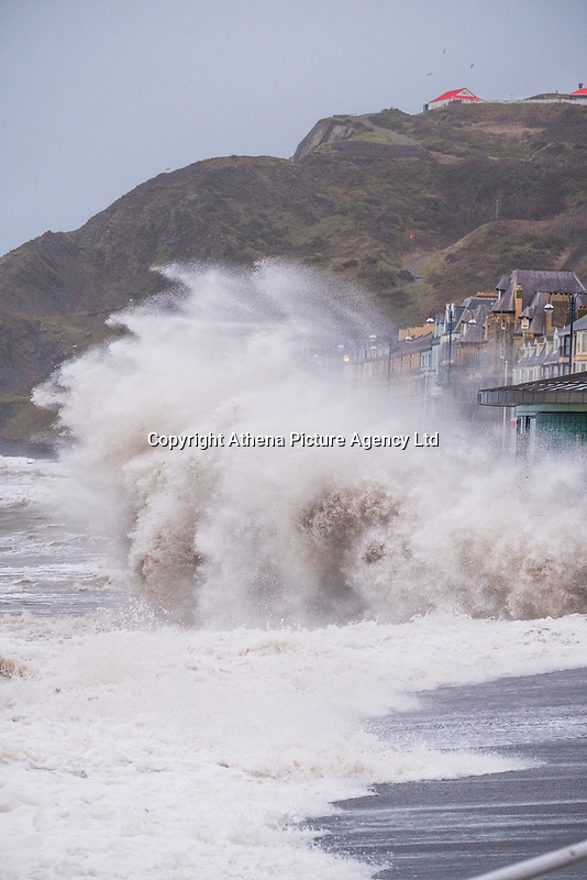 On the day after Storm Eleanor swept a trail of damage across the UK, strong westerly winds gusting over 75 mph whip the high Spring Tide into huge waves that batter the seafront at Aberystwyth, Wales, UK. Thursday 04 January 2017 <br />  <br /> A Yellow warning for wind  have been issued by the Met Office for virtually  the whole of England and Wales until 19.00 tonight, with the risk of damage and disruption to power supplies and travel greatest on the western shores of the country